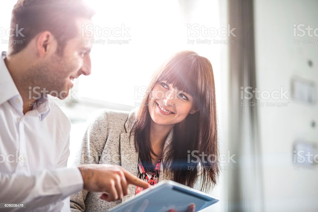 Young businessman and businesswoman using digital tablet in office – Foto