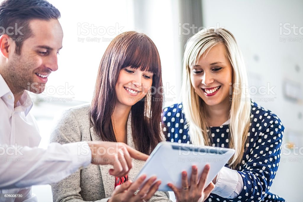 Young businessman and businesswomen using digital tablet in office – Foto