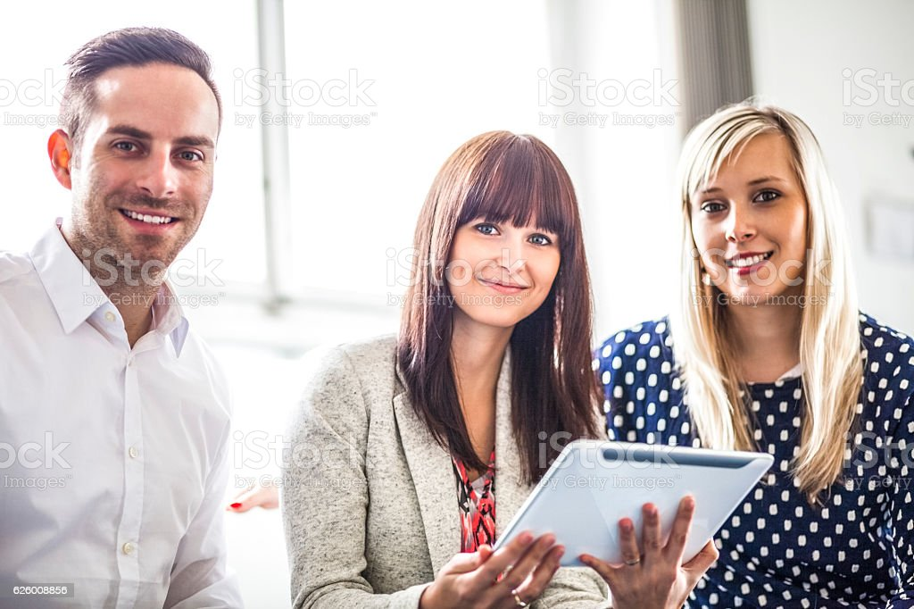 Young businessman and businesswomen with digital tablet in office Lizenzfreies stock-foto