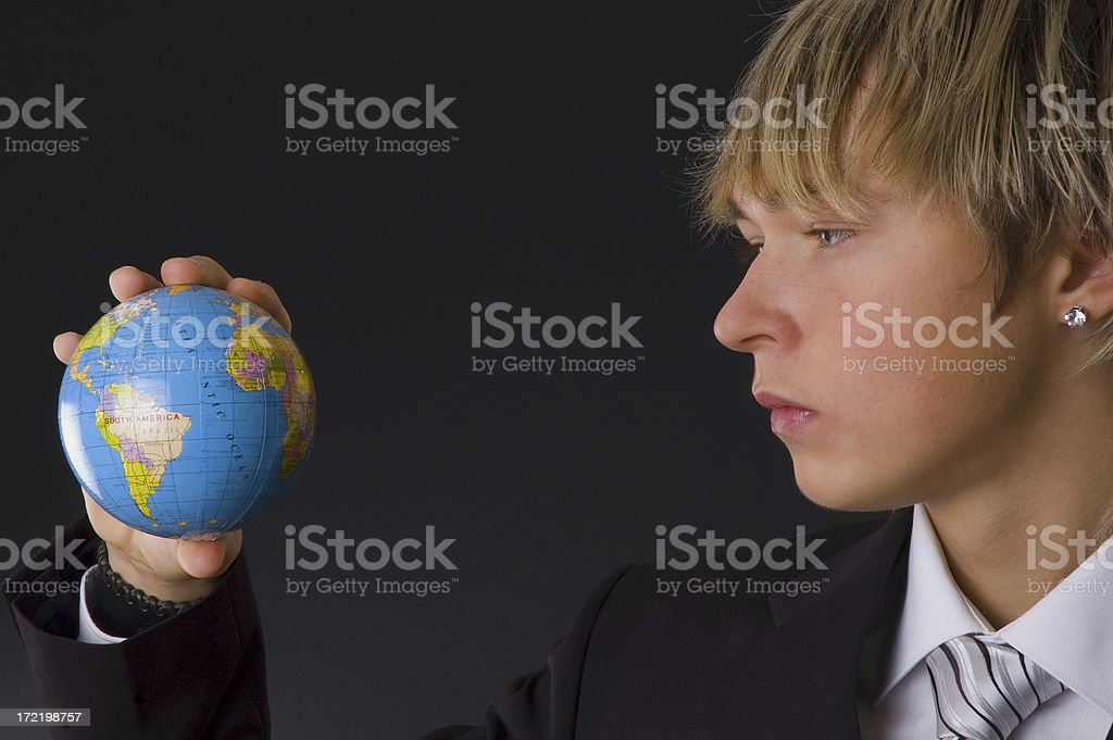 young businessman and globe royalty-free stock photo