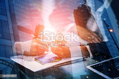 istock Young businessman and woman signing a paper in office. The concept of a successful business. 1045342822