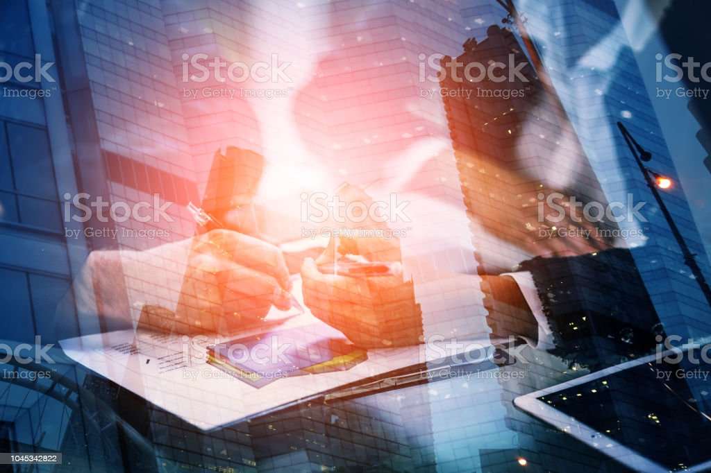 Young businessman and woman signing a paper in office. The concept of a successful business. stock photo