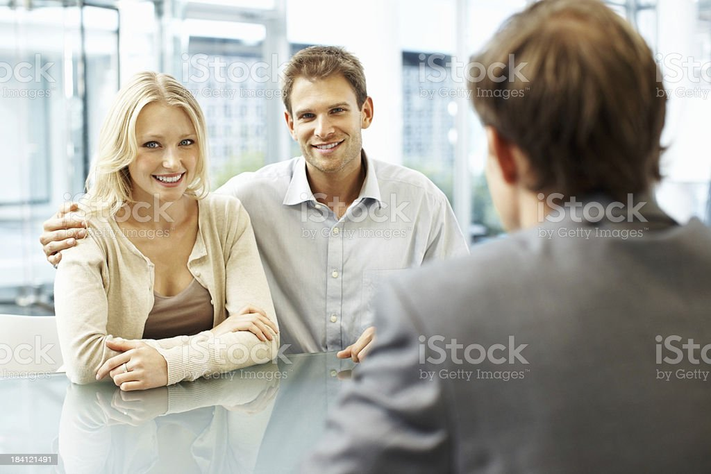 Young businessman and woman smiling royalty-free stock photo
