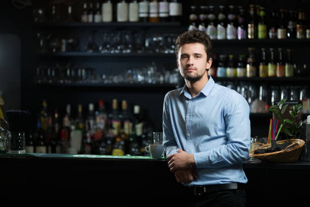 Young businessman at bar counter stock photo