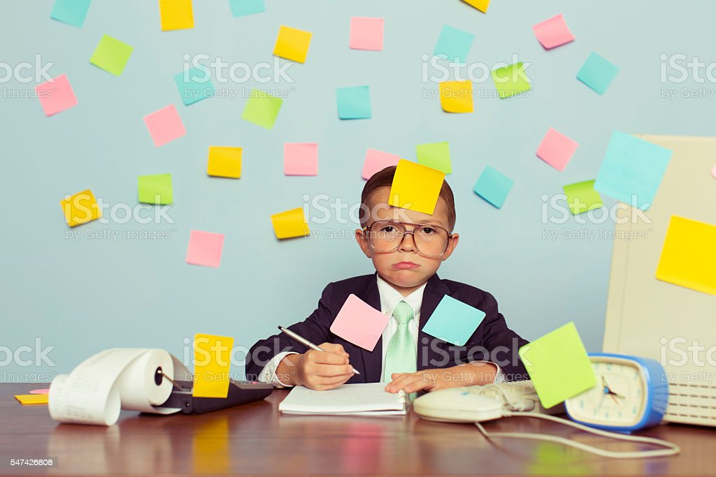Young Businessman at Desk Covered with Blank Sticky Notes stock photo