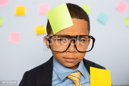 istock Young Businessman at Desk Covered with Blank Sticky Notes 547529440