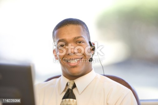 513583458 istock photo Young Businessman At His Desk 116225056