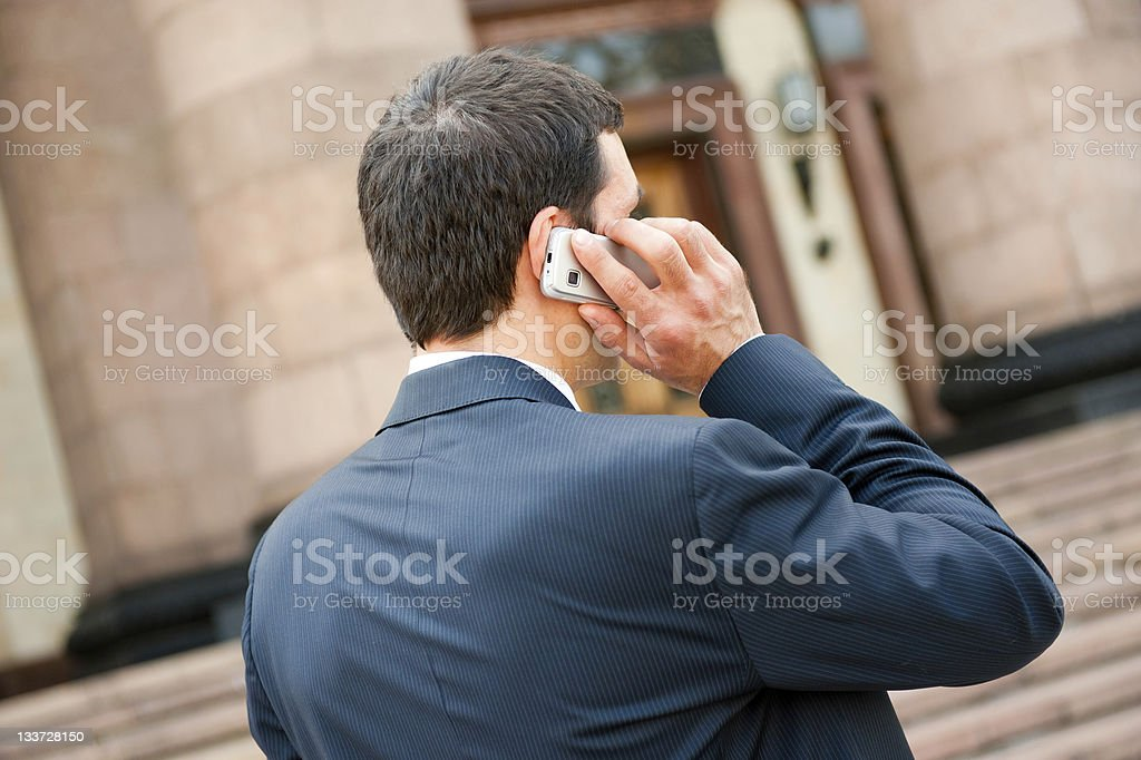 Young businessman calls on mobile royalty-free stock photo