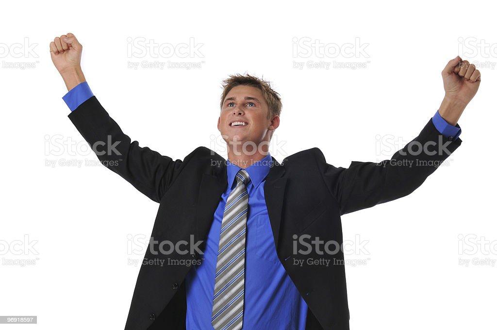 Young businessman celebrating royalty-free stock photo