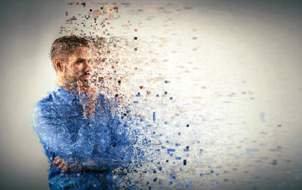 young businessman dispersing into pixels. - pixellated stock photos and pictures