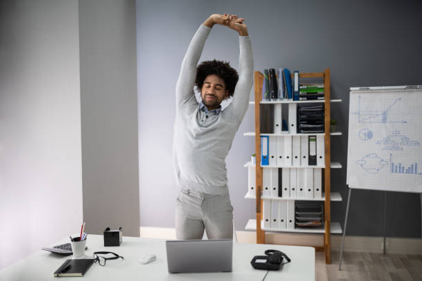 Young Businessman Doing Stretching Exercise stock photo
