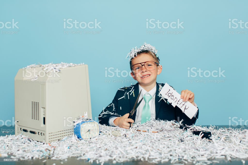 Young Businessman Dressed in Suit Buried In Shredded Paper royaltyfri bildbanksbilder