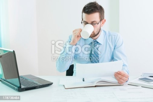 istock Young businessman drinking coffee 178736464