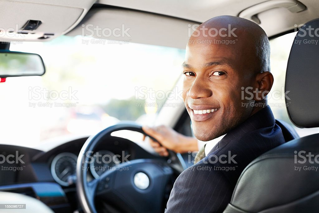 Young Businessman Driving in a Car stock photo