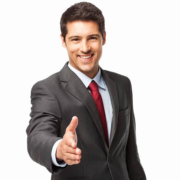Young Businessman Extending For A Handshake - Isolated stock photo