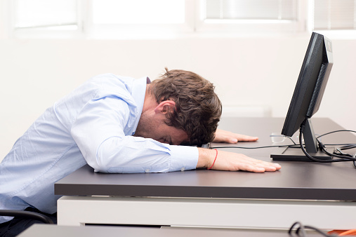 istock Young businessman fallen asleep in the office 498614661