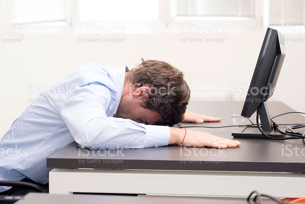 Young businessman fallen asleep in the office stock photo