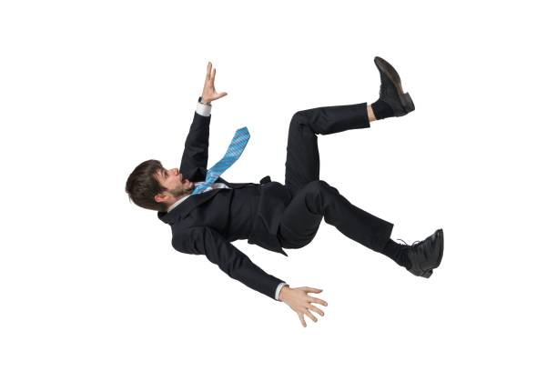 Young businessman falling down in free fall. Isolated on white background. stock photo