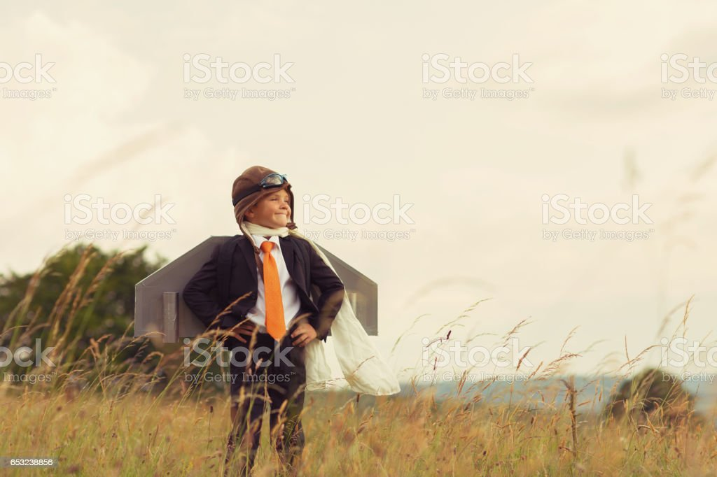 Young Businessman Flies Jet Pack into the Sky stock photo