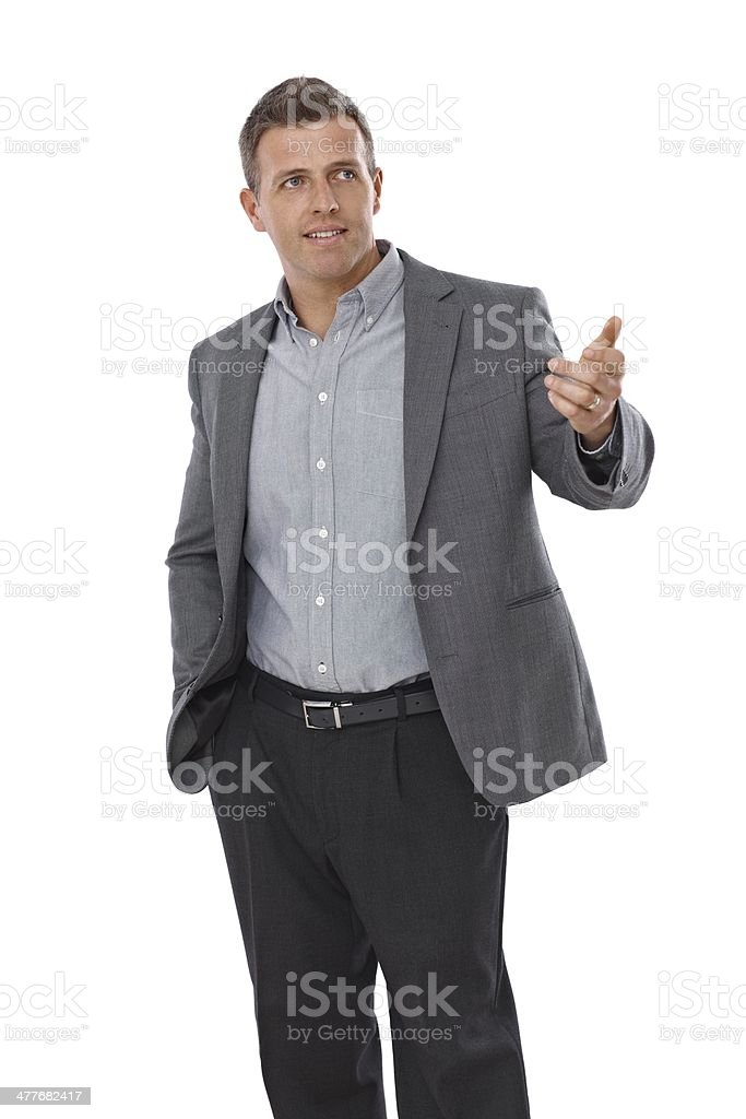 Young businessman gesturing royalty-free stock photo