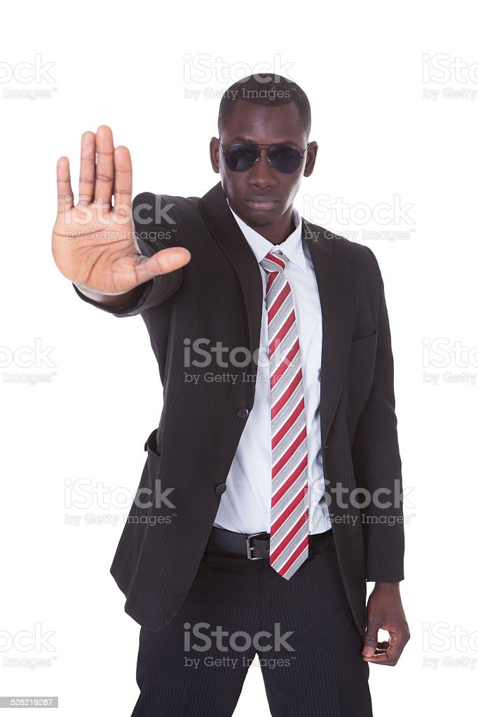 Young Businessman Gesturing Stop Sign stock photo