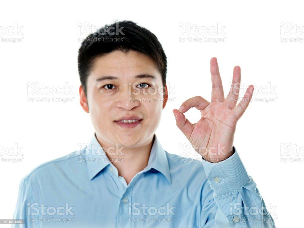 Young businessman giving okay sign Lizenzfreies stock-foto