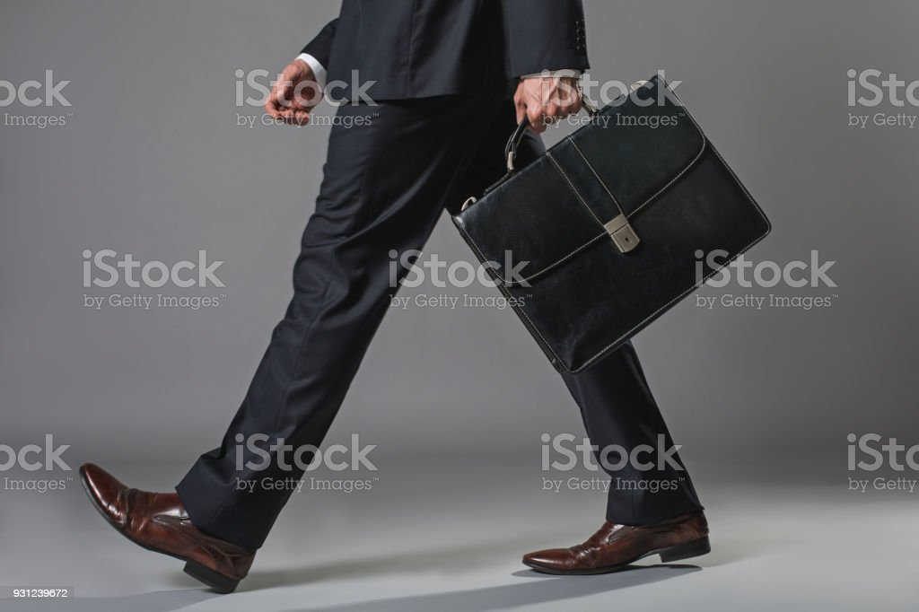 Young businessman going with a briefcase stock photo