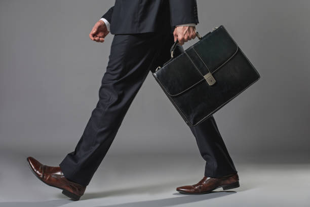Young businessman going with a briefcase - foto stock