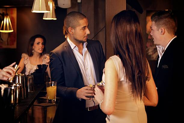 Young Businessman Hanging Out with Friends at the Bar stock photo