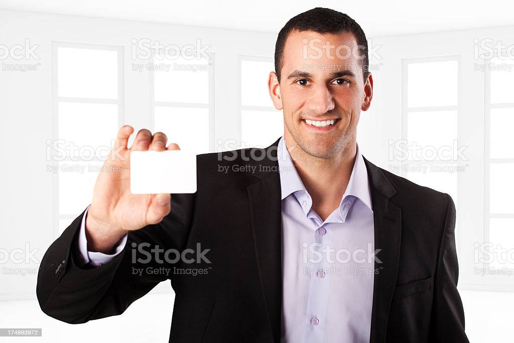 Young businessman holding a blank business card royalty-free stock photo