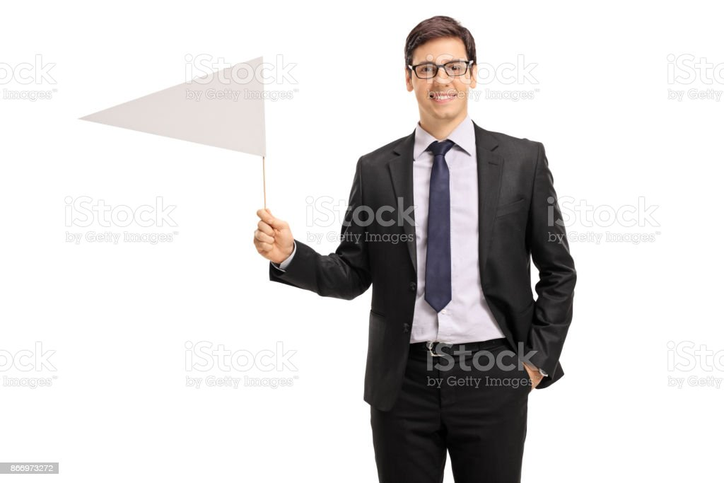 Young businessman holding a white flag stock photo