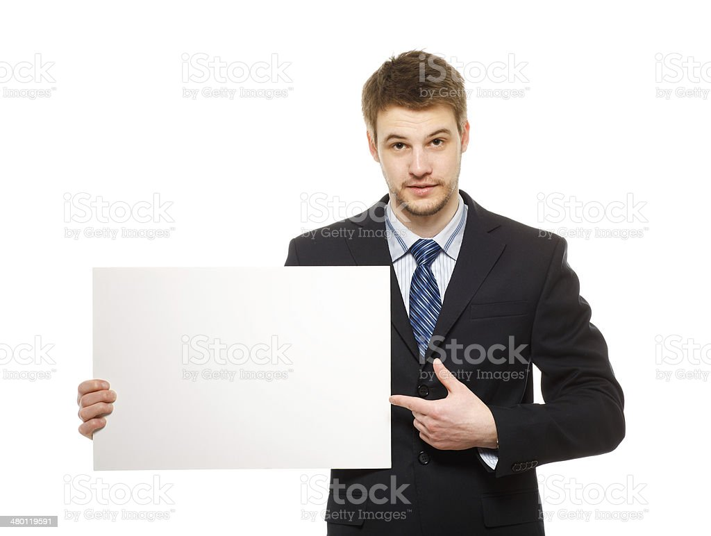 Young businessman holding a whiteboard. royalty-free stock photo