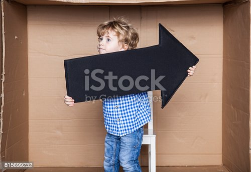 istock young businessman holding an arrow in his hands 815699232