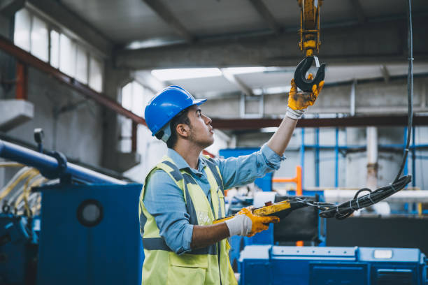 Young businessman holding and working with remote control for operating crane stock photo