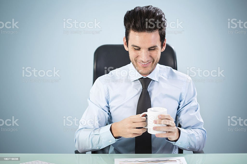 Young businessman holding cup of coffee royalty-free stock photo