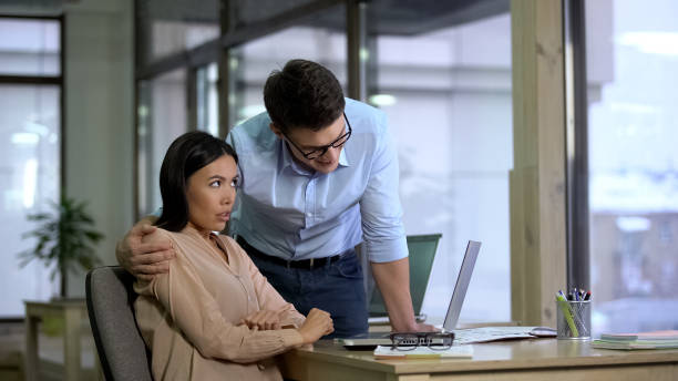 Young businessman hugging beautiful female secretary, sexual harassment, abuse Young businessman hugging beautiful female secretary, sexual harassment, abuse harassment stock pictures, royalty-free photos & images