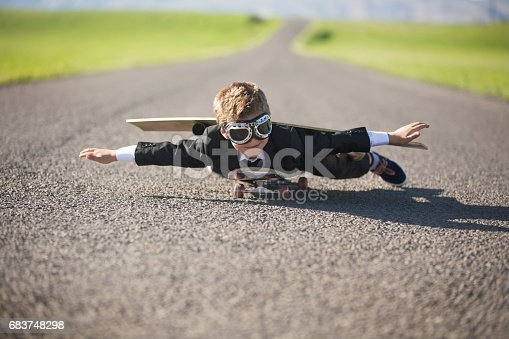istock Young businessman Imagines Flying On Skateboard 683748298