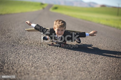 istock Young businessman Imagines Flying On Skateboard 685544722