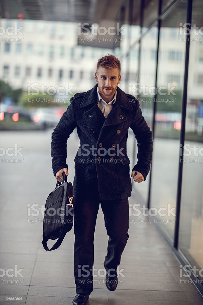 Young Businessman In A Hurry While Going To Work Stock Photo