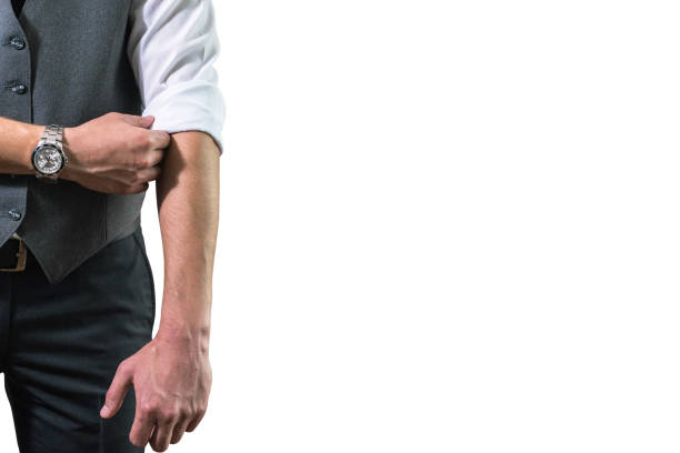 A young businessman in a white shirt rolls up his sleeves prepar stock photo