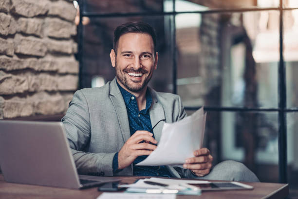 Young businessman in his office stock photo