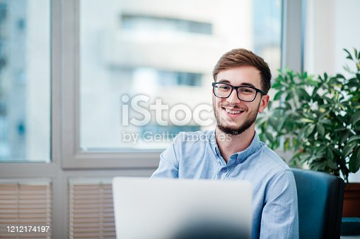 Young businessman in office working on laptop