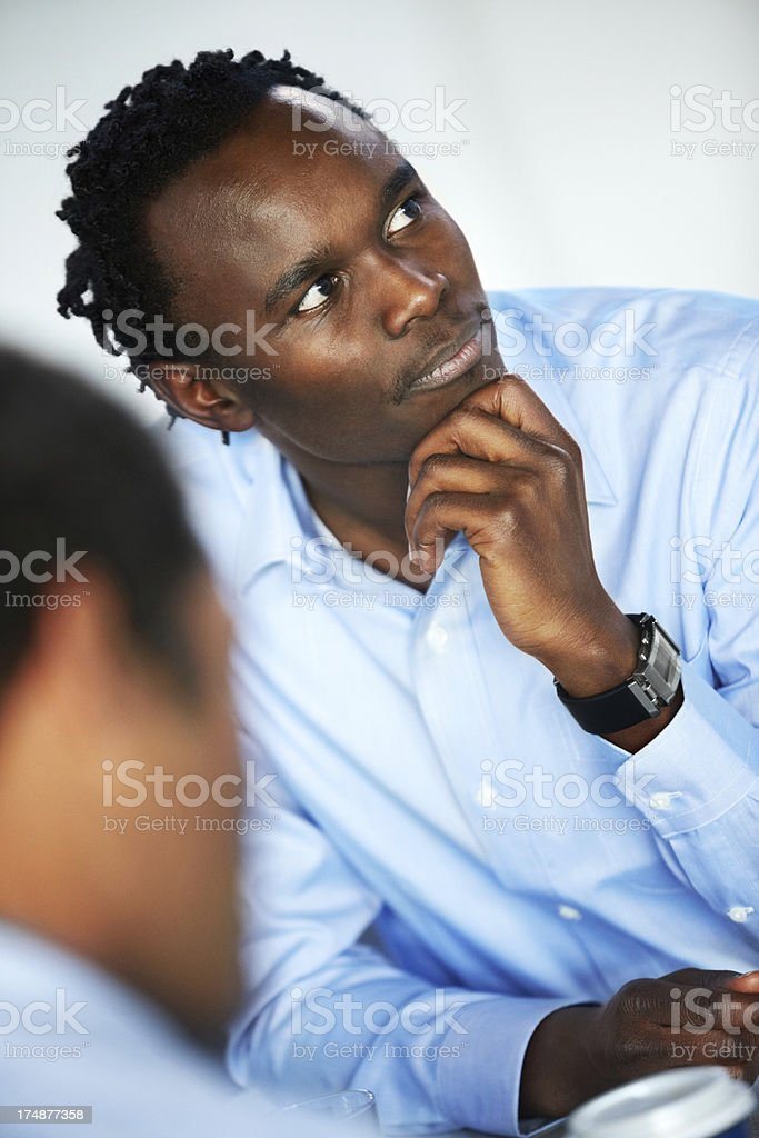 Young businessman in pensive mood during meeting royalty-free stock photo