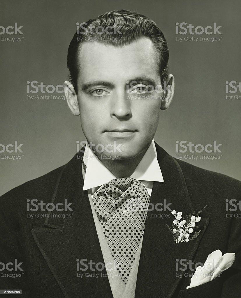 Young businessman in studio, (B&W), portrait stock photo