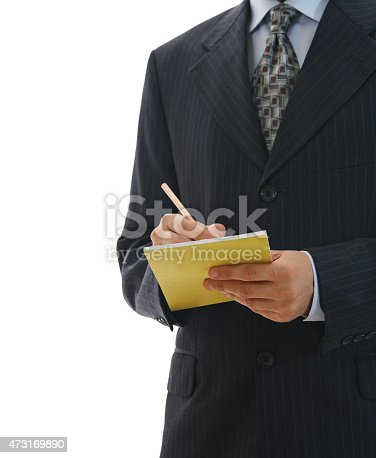 1175668510 istock photo Young businessman in suits taking notes on white background 473169890