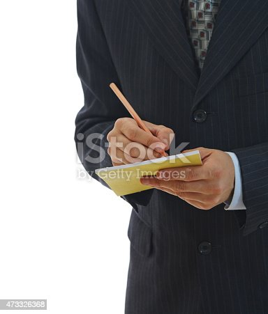 1175668510 istock photo Young businessman in suits taking notes on white background 473326368