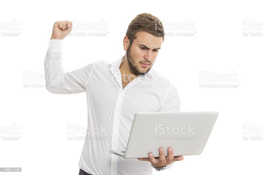 Young businessman is angry to his laptop royalty-free stock photo