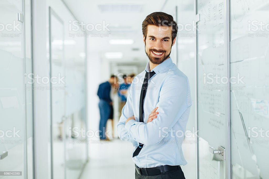 Young businessman is posing in hallway royalty-free stock photo