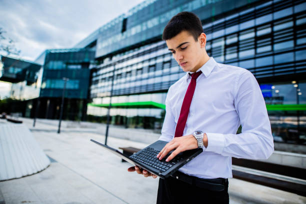Young businessman  is using laptop