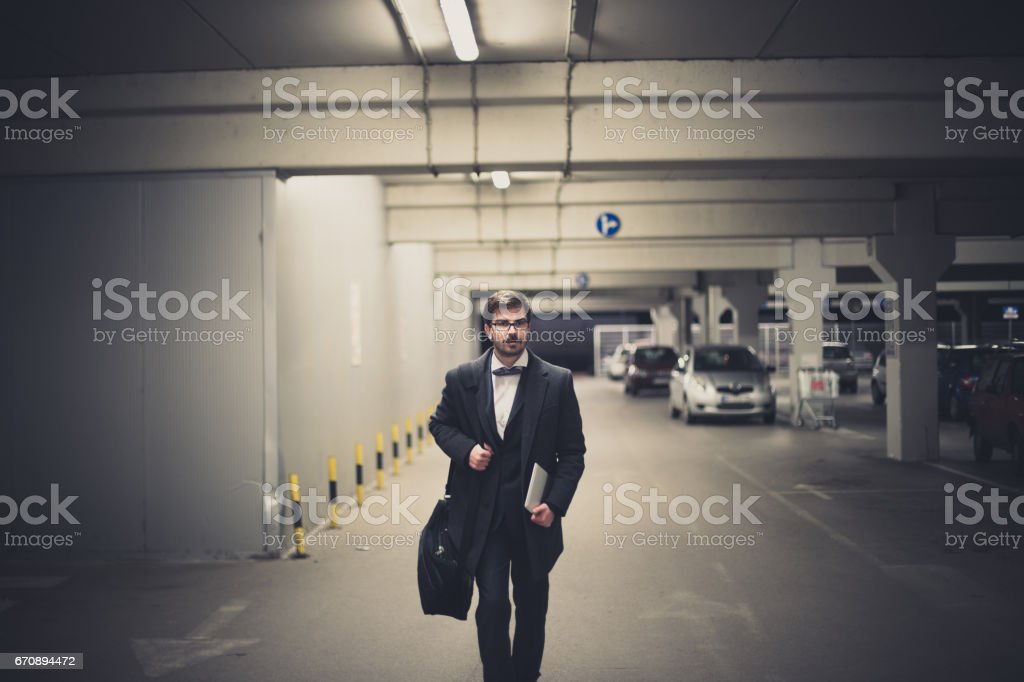 Young businessman is walking home after work stock photo